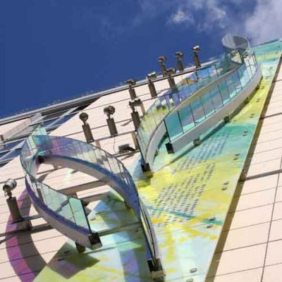 Decorative wall cladding with dichroic glass panels